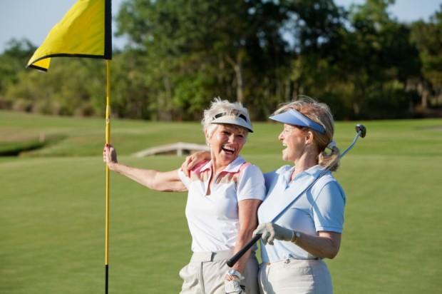 Senior women playing golf.