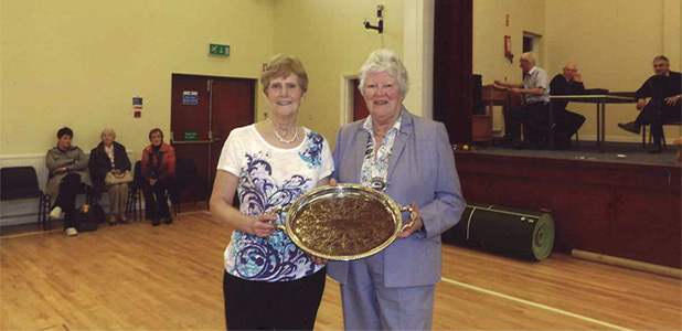 Bowls Finalist Evelyn Galbraith, Eglinton WI being presented with Milk Marketing Board Salver by Federation Chairman Mrs Margaret Collinson