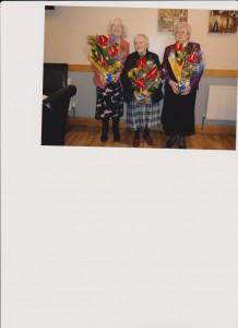 Mrs Ruddy, longest serving member, and founder members Madge and Meta