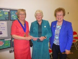 Erne Area President Sylvia Johnston presenting a token of appreciation to Mrs Margaret Collinson at the recent Erne Area Meeting. Included Mrs Mollie Linton, Erne Area Secretary.