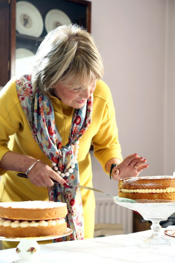 Jenny Bristow expertly inspecting one of the entries at the Bake Off semi-final.
