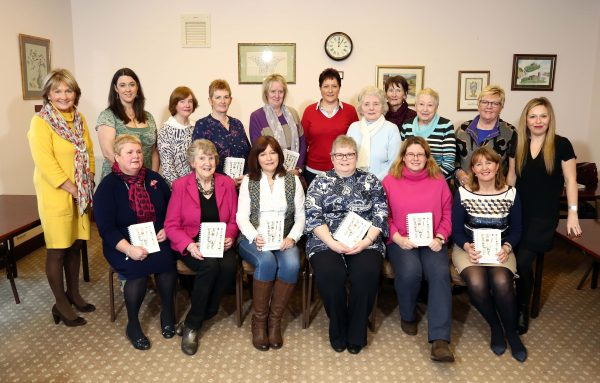 The Bake Off entrants pictured at WI Headquarters with judges Jenny Bristow and Michelle Greeves. The six semi-finalist winners are seated front row.